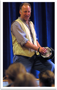 David Coffin playing the concertina at a school performance